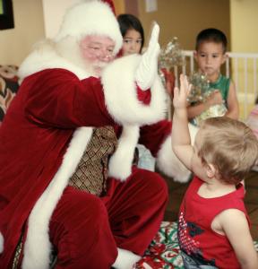 Santa claus gives a high five