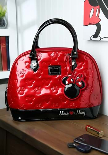 Mickey is a mouse that always has it going on! You'll look stylish when you sport this Mickey and Minnie Red and Black Patent Embossed Bag. #purse