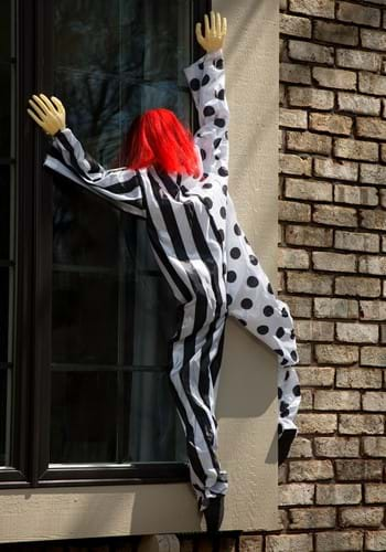 Click Here to buy Killer Clown Window Hanging Decoration from HalloweenCostumes, USA Funds & Shipping